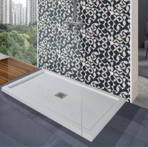 Plato de ducha de resinas con marco hecho a medida